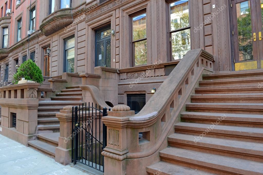 Brownstone apartment building with staircase