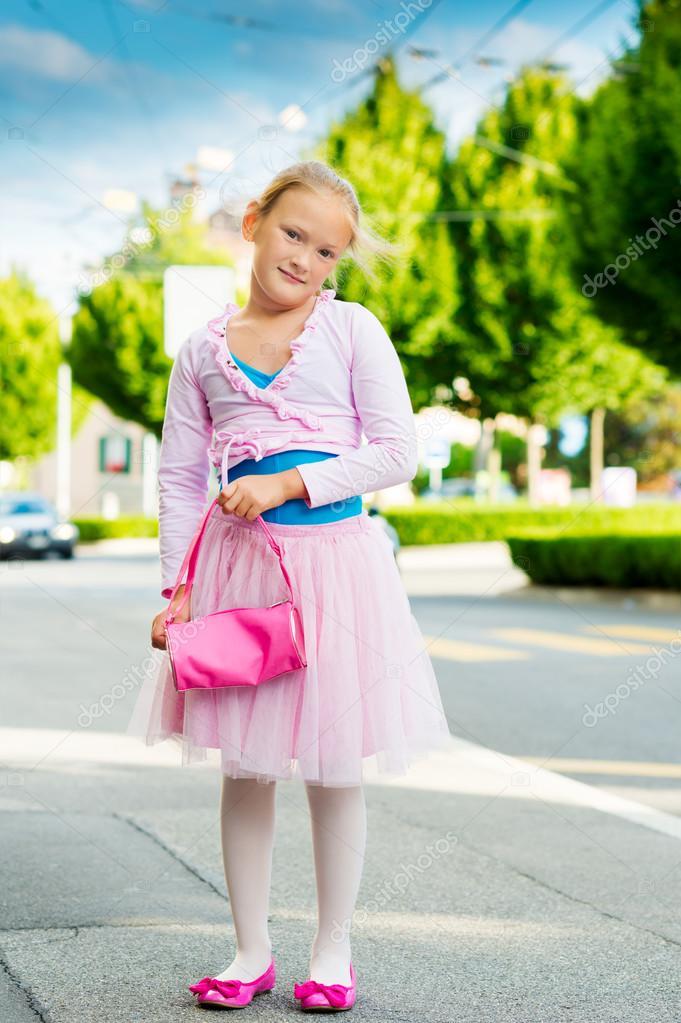 6a9966deb Cute little ballerina girl outdoors