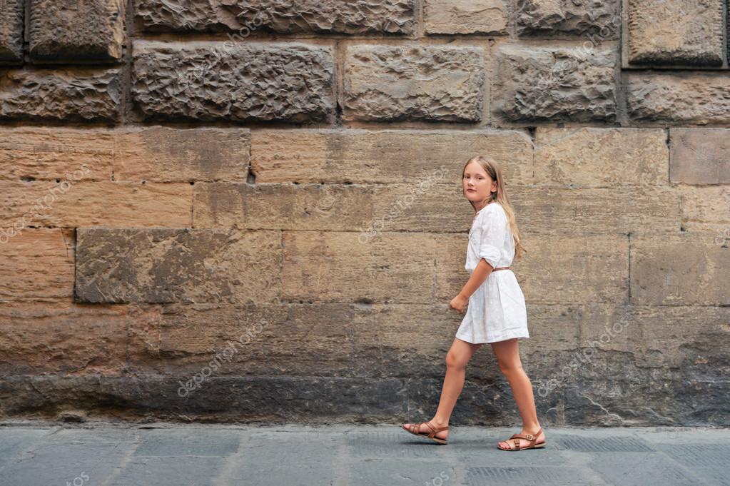 37fe82ea6 Outdoor fashion portrait of a pretty little girl
