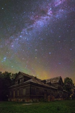 Old house under starry sky