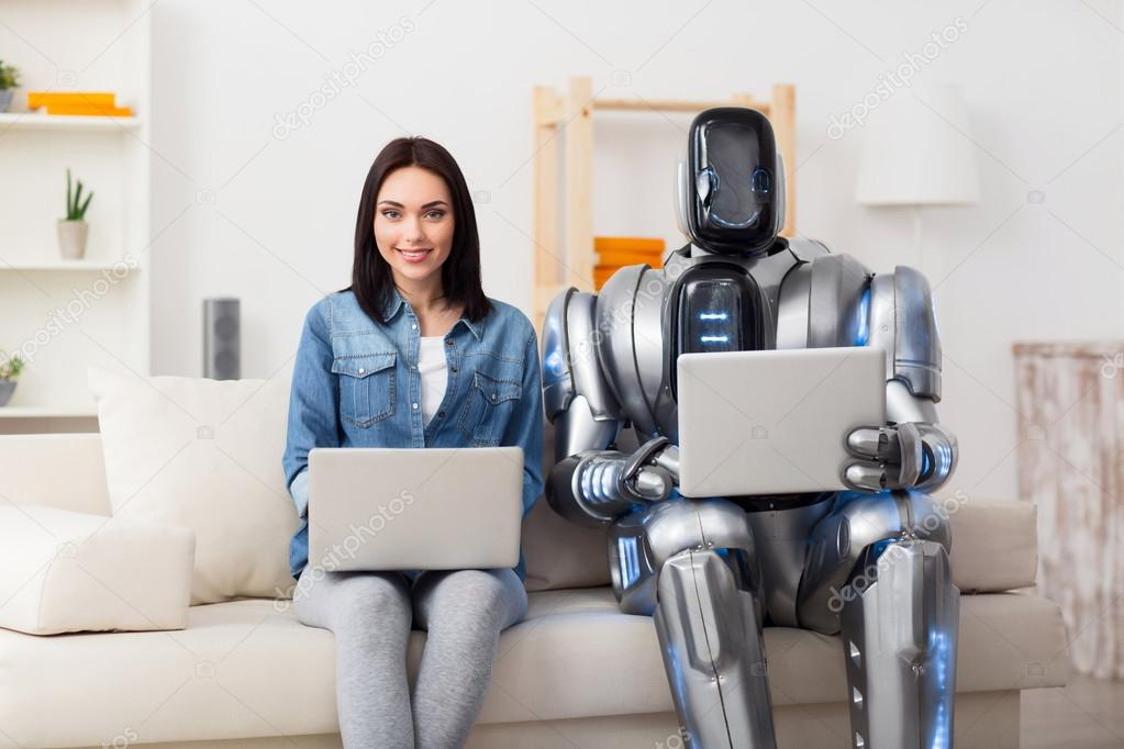 Positive girl and robot using laptops — Stock Photo © Dmyrto_Z #106960784
