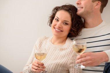 Positive couple drinking wine