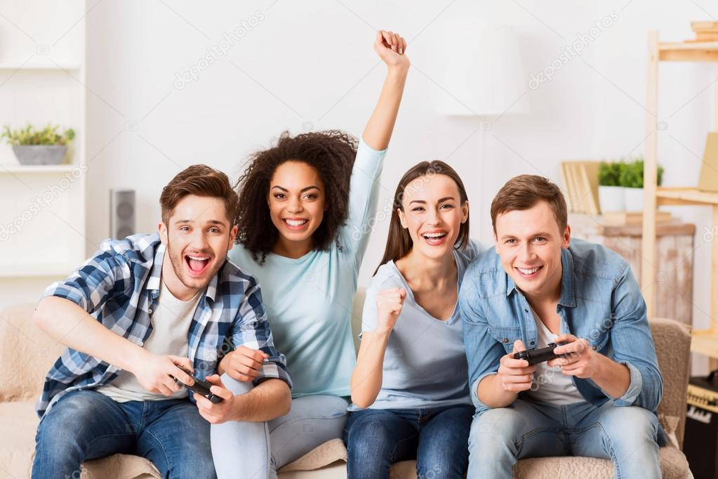 Cheerful friends playing video games — Stock Photo ...