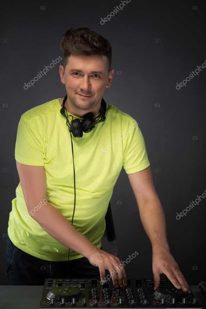 Dj at work isolated on dark grey background