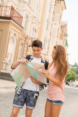 Couple of tourists looking at the map