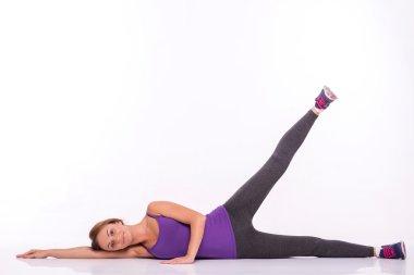 Sportswoman does the exercises