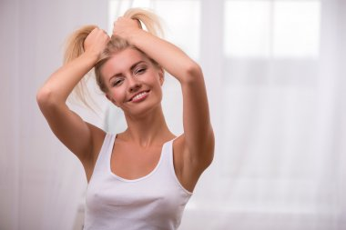 Girl tousling her hair