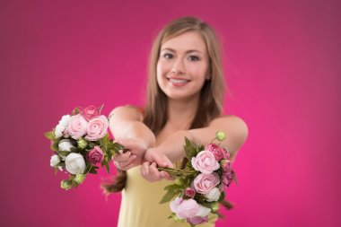 Girl holding  bunches  of roses