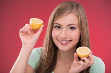 Girl  with halves of lemon