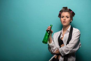 Cute brunette   with beer bottle