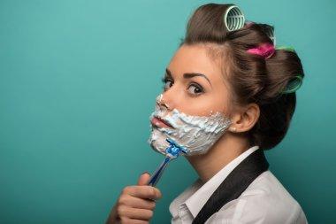 Woman shaving with razor
