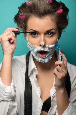 Brunette  with razor  applying mascara
