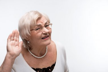 Curious granny trying to hear something