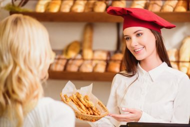 Beautiful young women at bakers shop