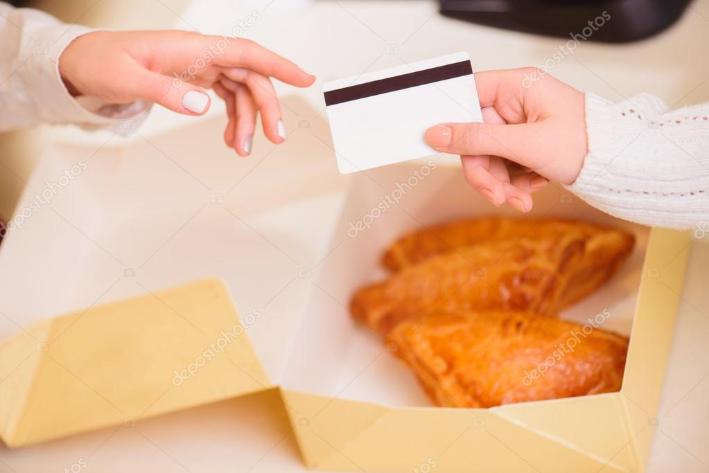 Customer paying to shop assistant