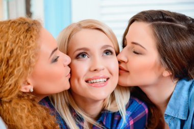 Female friends  kissing each other