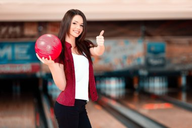 Woman holding a bowling ball