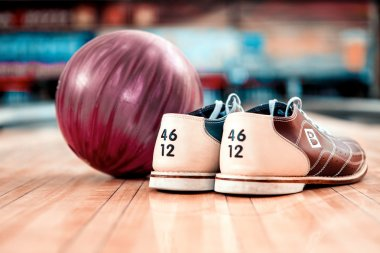 Bowling shoes and lilac ball