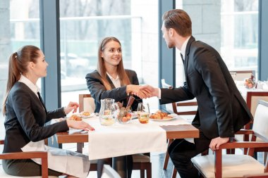 Businessman greets the partners