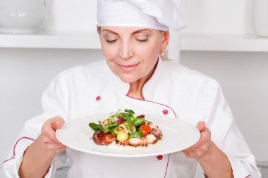 Chef-cook smelling   octopus salad