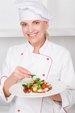 Chef-cook presenting meals