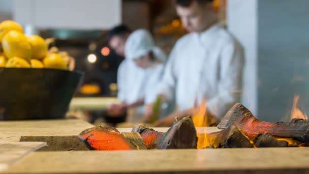 Selective focus on burning fire in restaurant kitchen
