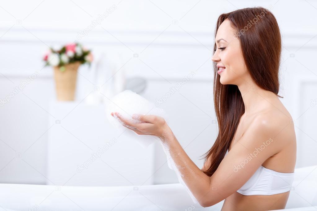 Nude girl kissing a girl