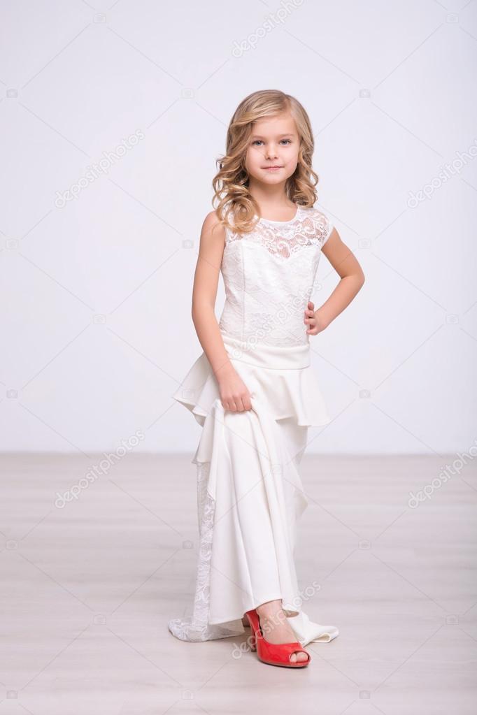 Cute little girl standing in a wedding dress — Stock Photo ...