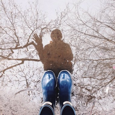 Feet in rubber boots