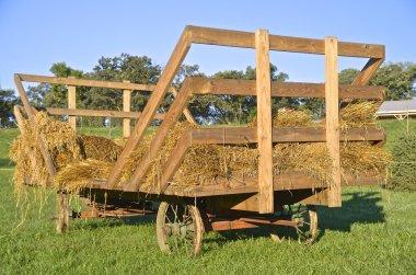Bundles of grain on an old straw rack