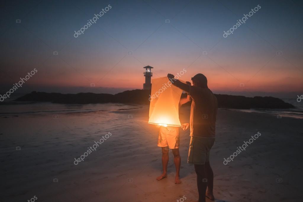 People lighting Paper lantern
