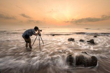 Photographer shooting seascape