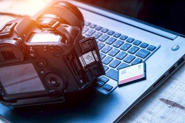 Camera laying on laptop