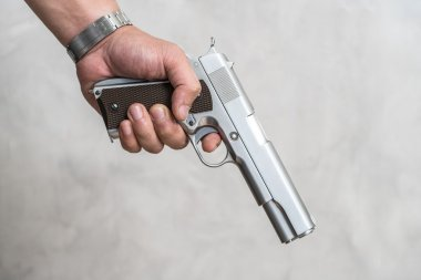 Male hand holding gun
