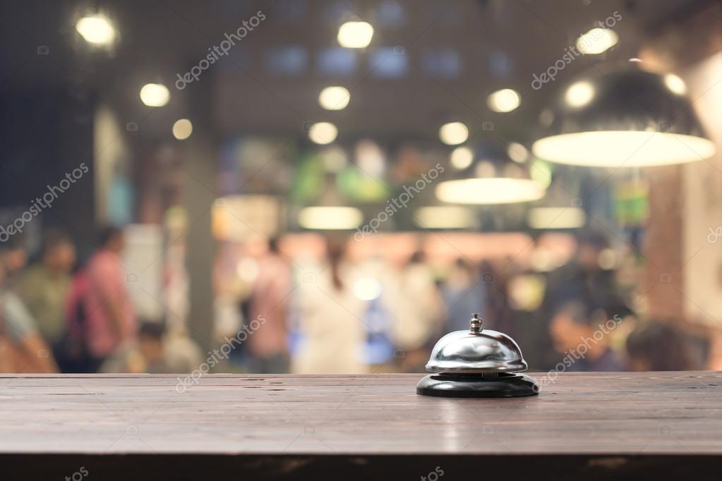 Restaurant bell on bar with bokeh