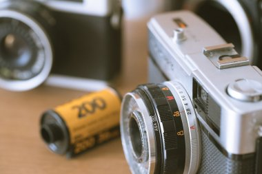 old film cameras and roll of film