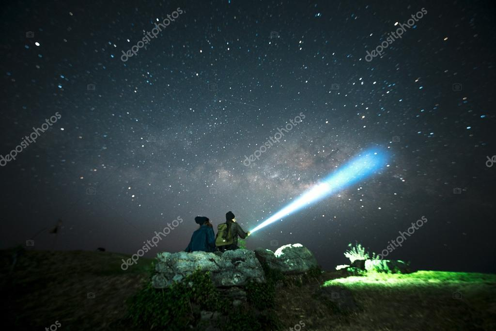 Couple looking at Milky Way stars