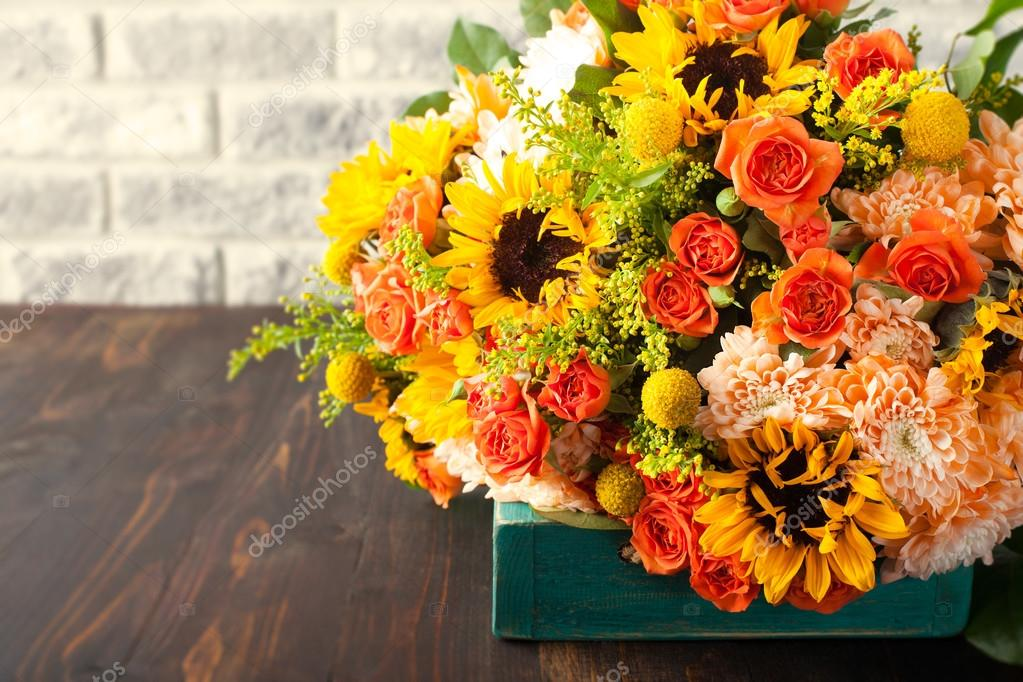 Colorful bouquet of flowers in turquoise box wooden table — Stock ...