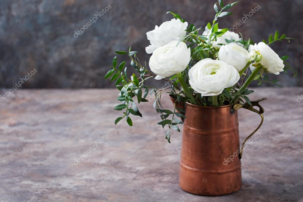 White ranunculus flowers Brown background
