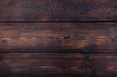 Dark brown wooden background with high resolution. Top view Copy space.