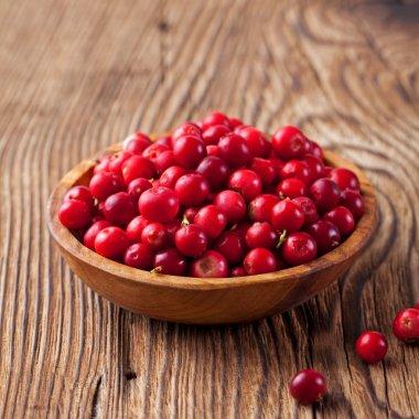 Cowberries, red bilberries, cranberries in a bowl