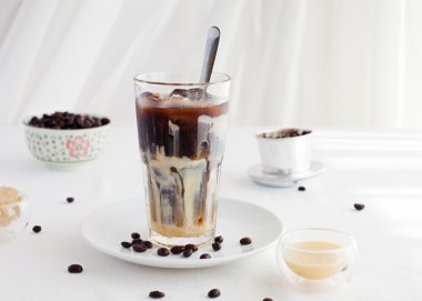 Ice coffee with condensed milk, traditional Vietnamese, Thai coffee with coffee beans
