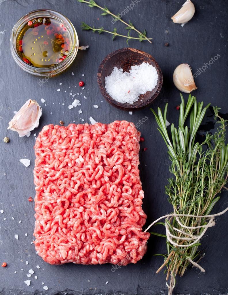Minced meat on a slate stone black board.