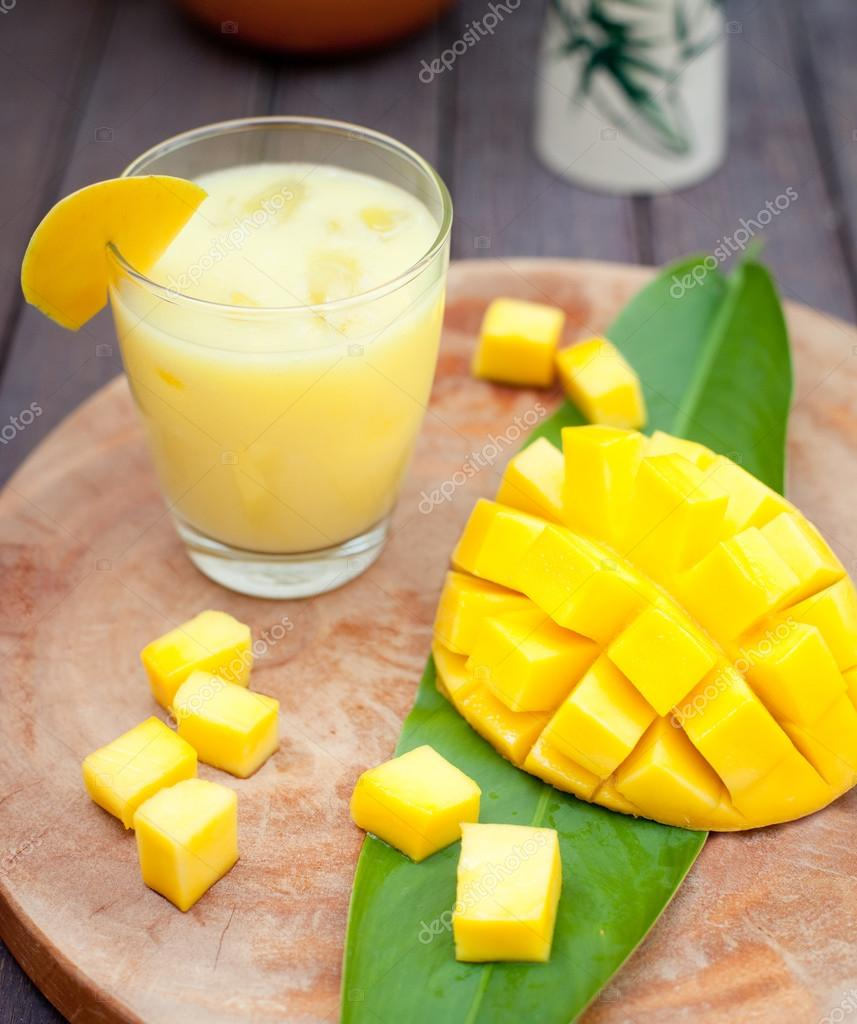 Mango juice, smoothie ,mango fruit on a wooden background