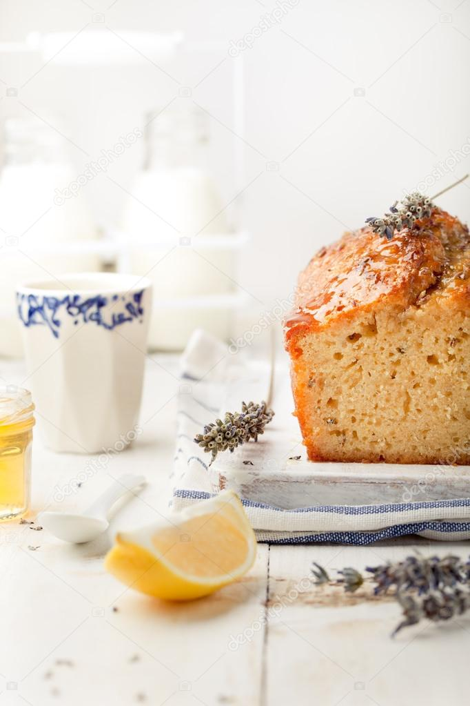 Lavender, lemon cake with fresh lemons and lavender flowers