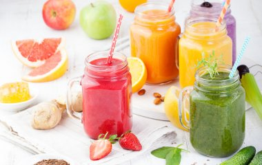 Smoothies, juices, beverages, drinks variety with fresh fruits and berries on a white wooden background