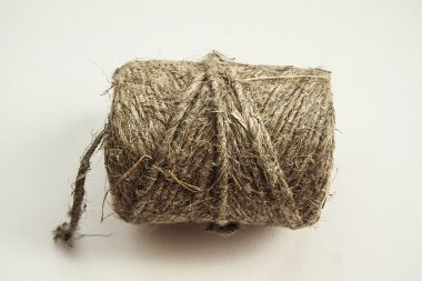 A coil of rope, twine on a white background