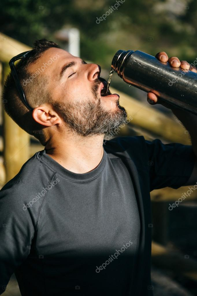 Close-up of traveler drinking from thermos
