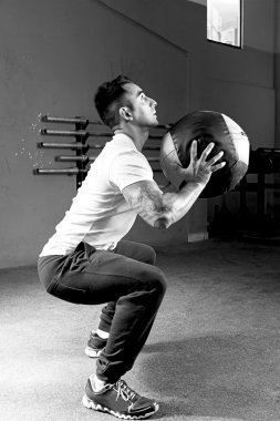 man doing ball slams exercise - crossfit workou