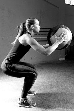 woman doing ball slams exercise - crossfit workou